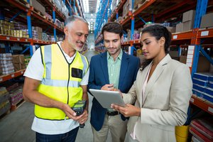 Warehouse team discussing with digital tablet p732