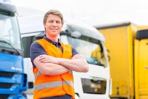 Forwarder or driver in front of trucks in depot p546en