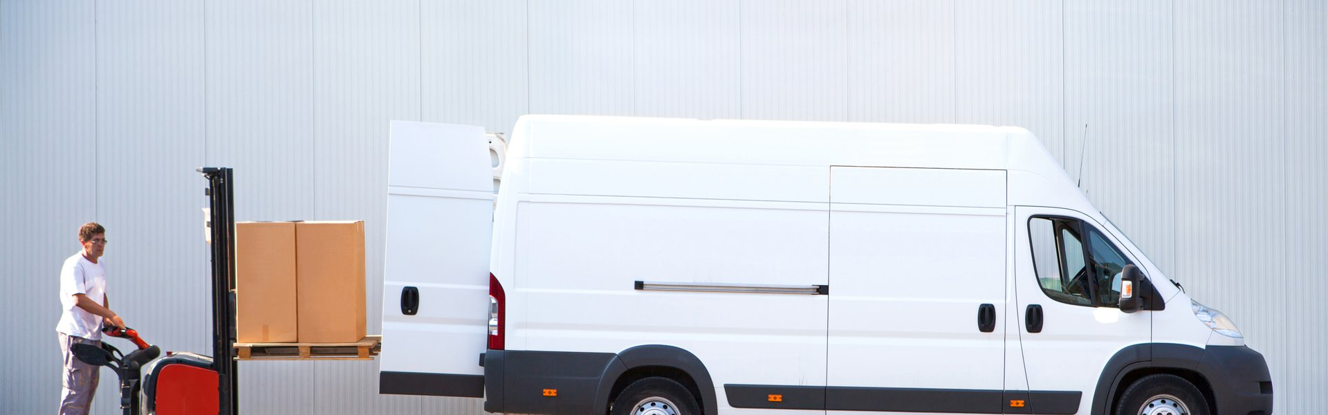 Courier is loading the van with parcels. p800